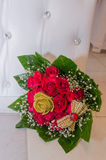 Wedding bouquet of red roses on a white living chair. Rahat, Negev, Israel - August 26, Ulam Lotus-Hina  -Rahat, 2015 in Israel Stock Images