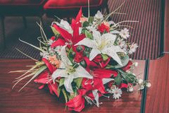 Wedding bouquet of red and white artificial flowers stock photos