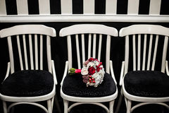 Wedding bouquet of red and white flowers on a black and white ba Stock Photos