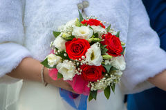 Wedding bouquet of red white flowers held by the bride Royalty Free Stock Photos