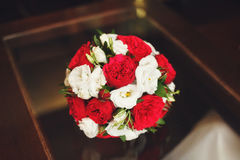 Wedding bouquet of red and white roses on table Royalty Free Stock Photos