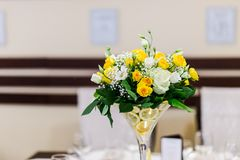 Wedding bouquet on restaurant table Stock Photos