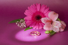 Wedding bouquet and ring. On magenta background Stock Images