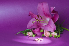 Wedding bouquet and rings. On magenta background Stock Photo