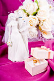 Wedding bouquet and rings Stock Photos
