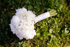 Wedding bouquet with rings Stock Photos