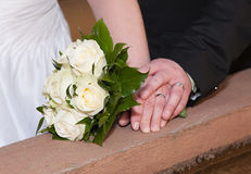 Wedding bouquet and rings. Wedding bouquet rings and hands Royalty Free Stock Photo
