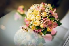 Wedding bouquet and wedding rings. the attributes of the groom. newly married couple. the preparations of the groom royalty free stock images