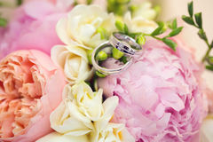 Wedding Bouquet and Rings. Close up of engagement rings  on wedding bouquet Royalty Free Stock Image