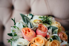 Wedding bouquet with rings of newlyweds Royalty Free Stock Photo