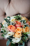 Wedding bouquet with rings of newlyweds Stock Image