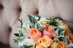 Wedding bouquet with rings of newlyweds Stock Images