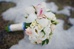 Wedding bouquet with rings Stock Images