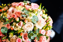 Wedding bouquet with rings. Rings on a spring bouquet of bride stock images