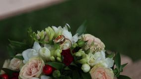 Wedding bouquet and rings. Wedding bouquet and two gold rings stock video