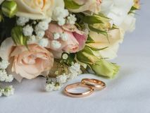 Wedding bouquet and rings. Stock Image