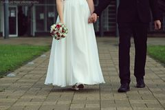Wedding bouquet and rings. Wedding bride with groom walk Royalty Free Stock Photography