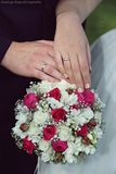 Wedding bouquet and rings. Wedding bride with wedding bouquet Stock Photos