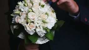 Wedding bouquet and ringswedding bouquet and rings. beloved. Wedding bouquet and ringswedding bouquet and rings. A man with a bouquet for his beloved stock video