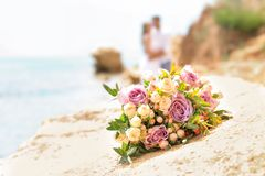 Wedding bouquet on rocky beach. Closeup stock image