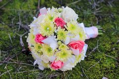 Wedding bouquet of rose, chrysanthemum , iris, and gypsophila on the forest moss.  Stock Images