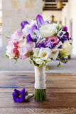 Wedding bouquet with rose, freesia, eustoma and lavender flowers Royalty Free Stock Photography