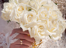Wedding bouquet of roses. In hand of the bride Stock Photo