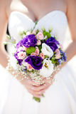 Wedding bouquet with roses and alstromeria. Colorful wedding bouquet in bride's hands with eustomas and alstromeria Stock Images