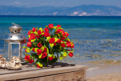 Wedding bouquet of roses on the beach Royalty Free Stock Photo