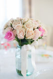 Wedding bouquet of roses. Beautiful wedding bouquet of delicate beige roses stands on the table Stock Photo