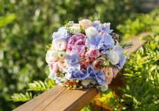 Wedding bouquet of roses and blue fresia Royalty Free Stock Images