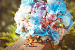 Wedding bouquet of roses and blue fresia Stock Photography