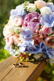 Wedding bouquet of roses and blue fresia Royalty Free Stock Photo