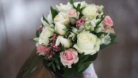 Wedding bouquet of roses. Bride`s bouquet on wedding day. Bouquet of different flowers. Bouquet of beautiful pink and. White or red roses on the dressing stool Stock Image