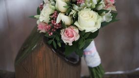 Wedding bouquet of roses. Bride`s bouquet on wedding day. Bouquet of different flowers. Bouquet of beautiful pink and. White or red roses on the dressing stool Stock Images