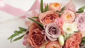 Wedding bouquet of roses. Bride`s bouquet on wedding day. Bouquet of different flowers. Bouquet of beautiful pink and stock video footage