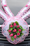 Wedding bouquet of roses on a car cowl Stock Image