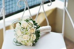 Wedding bouquet of roses on a chair Stock Image