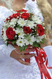 Wedding bouquet with roses and daisies. In hand of the bride Royalty Free Stock Photos
