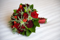 Wedding bouquet of roses and eryngium Royalty Free Stock Photo