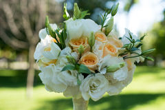 Wedding bouquet of roses and eustoma. On blurred background. Wedding bouquet of roses and eustoma . closeup. On blurred background Royalty Free Stock Photography
