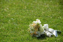 Wedding bouquet of roses on green grass Royalty Free Stock Image