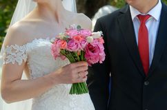 Wedding bouquet of roses. In hand of the bride Royalty Free Stock Photo