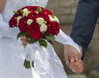 Wedding bouquet of roses. In hand of the bride Royalty Free Stock Image