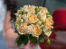 Wedding bouquet with roses. In hand of the bride Royalty Free Stock Image