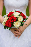 Wedding bouquet of roses in hands of the bride Stock Photos