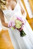 Wedding bouquet of roses in hands of the bride Stock Photo