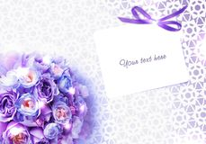 Wedding bouquet of roses and an invitation card with lace background. Royalty Free Stock Photography