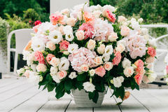 Wedding bouquet of roses. Wedding bouquet of living roses on a wooden gray floor Royalty Free Stock Photos