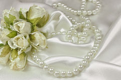 Wedding bouquet of roses and pearl necklace Stock Photos